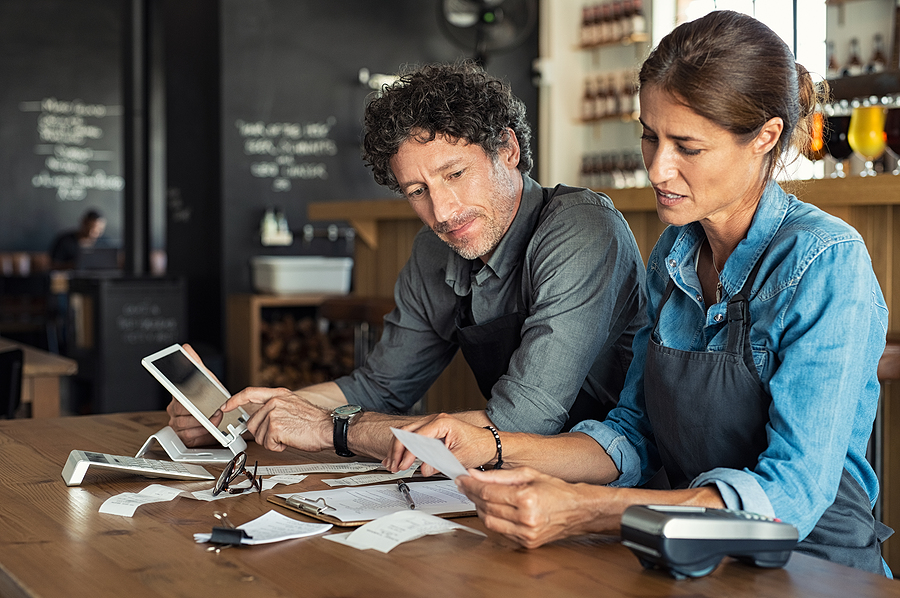 Woman and man reviewing business tasks