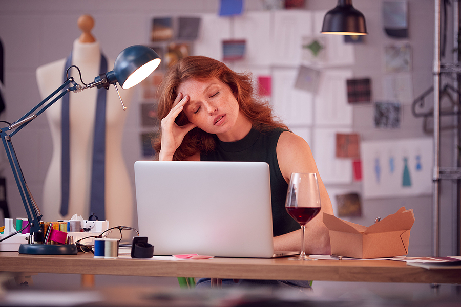 Worried female business owner at computer